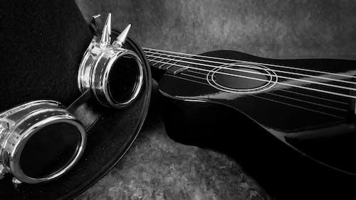 Free stock photo of black and white, goggles, top hat, ukulele