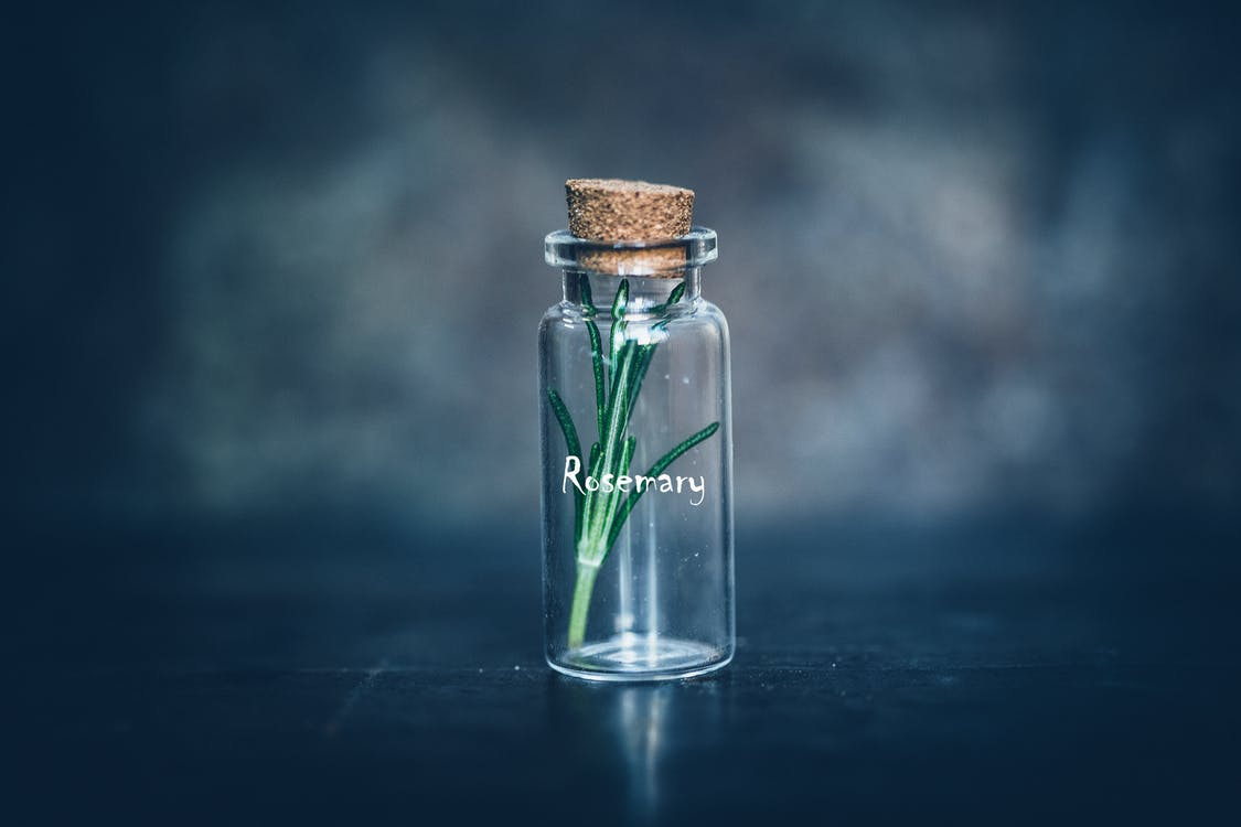 Empty Clear Glass Bottle