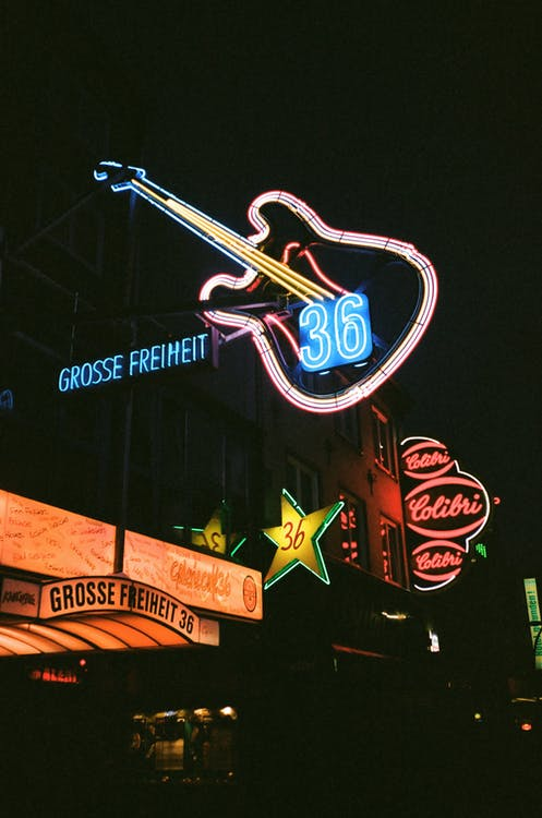 Photo of Building With Lighted Neon Signages