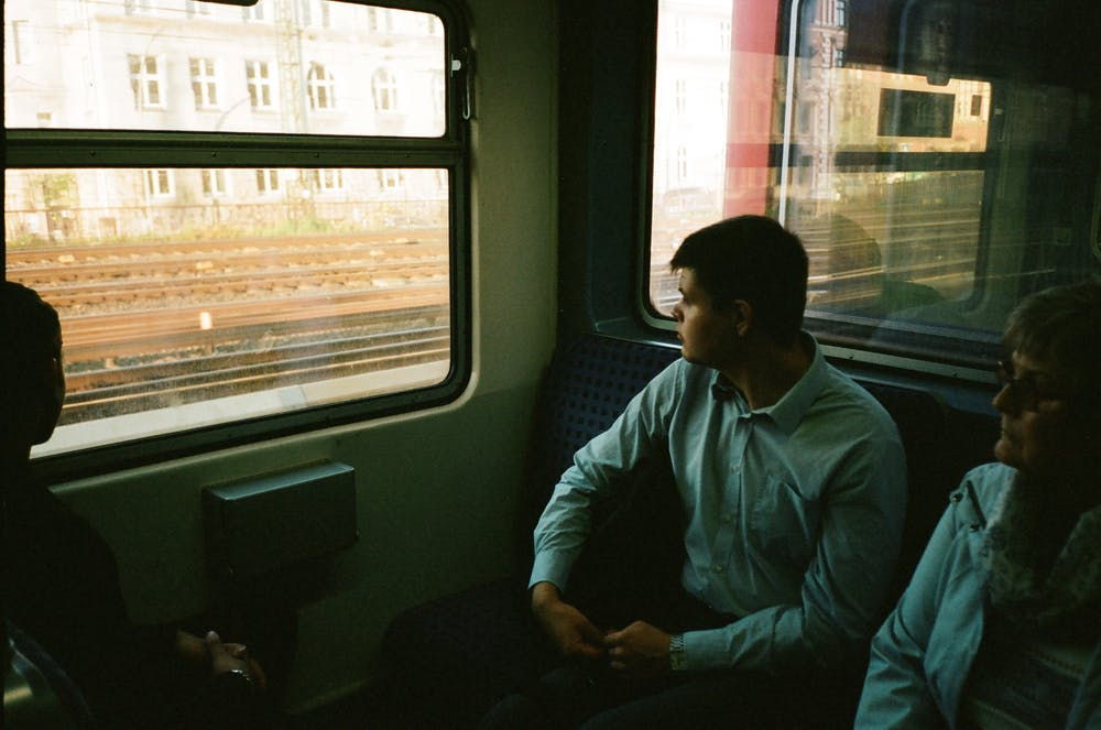 Two people sitting inside the train | Photo: Pexels