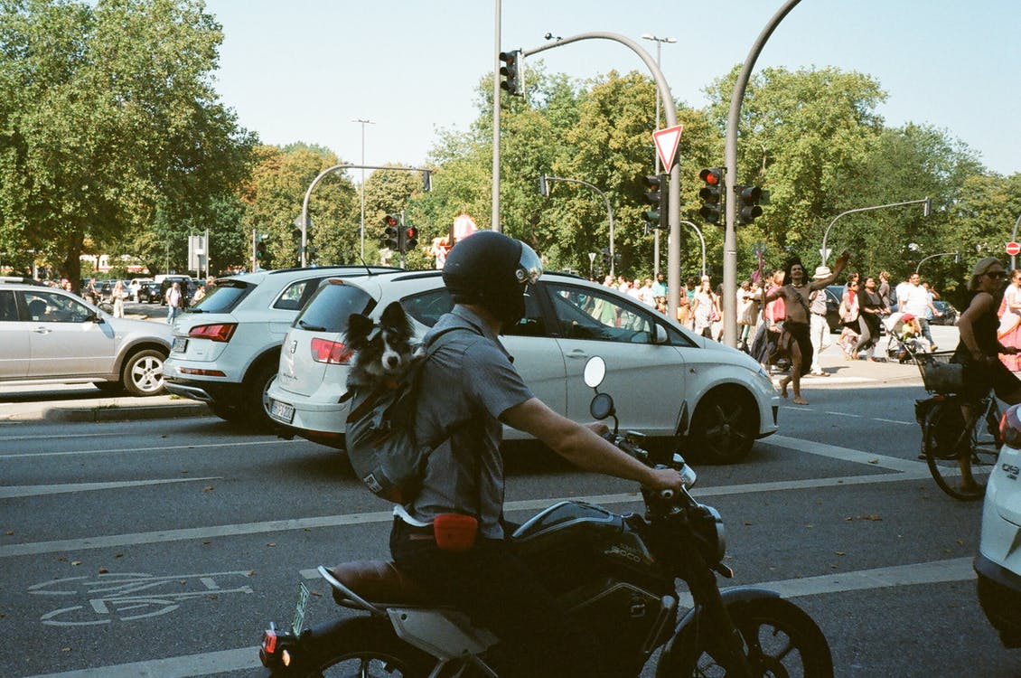 Man Riding Motorcycle on the Streets
