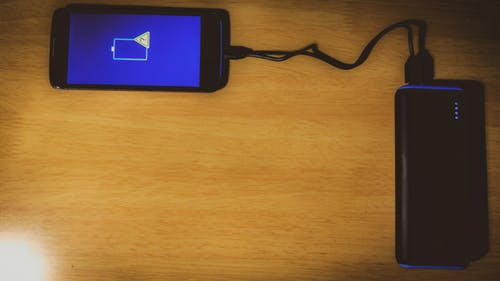 Free stock photo of background, charging, mobile ph9ne, smartphone