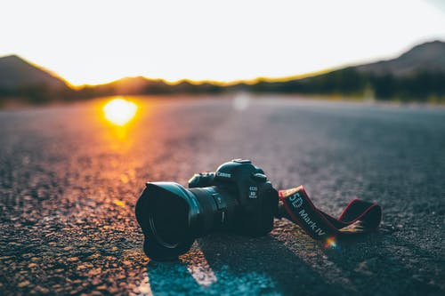 Black Dslr Camera on Concrete Road