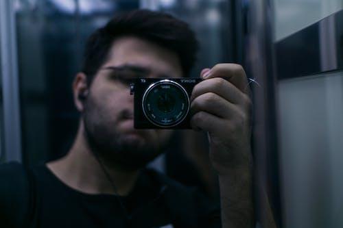 Free stock photo of easphones, lift, mirror