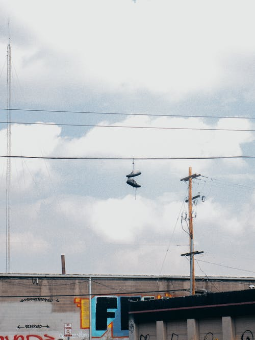 Pair of Shoes Hanging on Electric Wire
