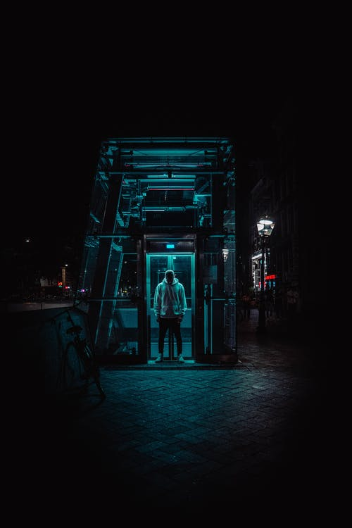Man Standing Under Struture
