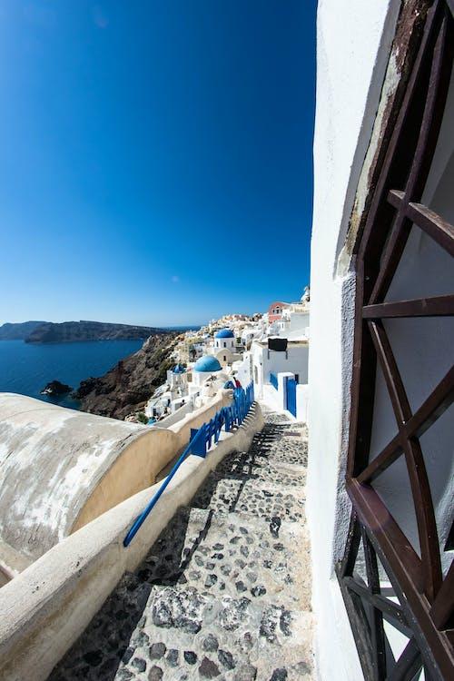 Foto d'estoc gratuïta de barri antic, cel blau, escala de pedra, escales