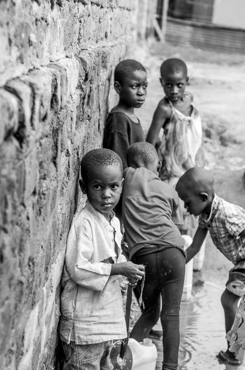 Grayscale Photography of Children Near the Wall