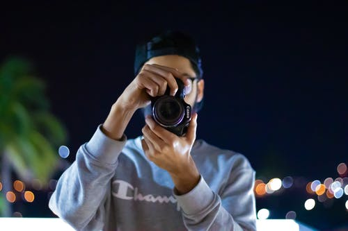 Photo of Person Holding a Camera
