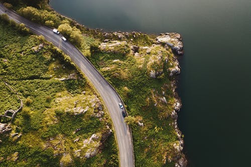 Aerial Photo of Road Beside Body of Water