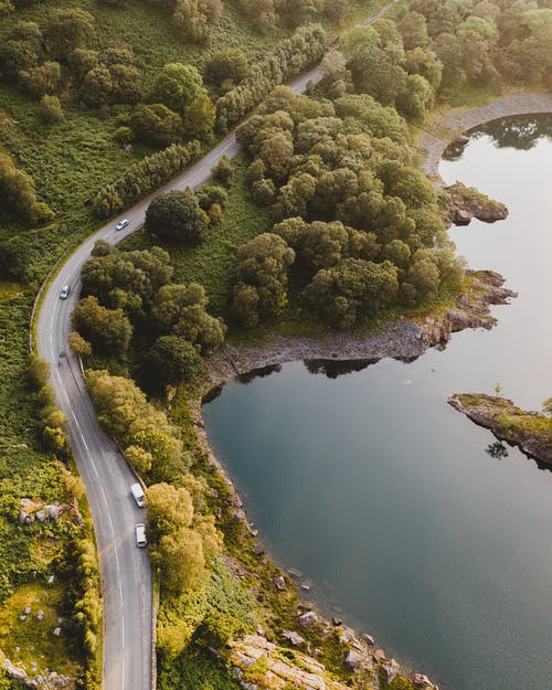 Aerial Photography of Roadway and Body of Water