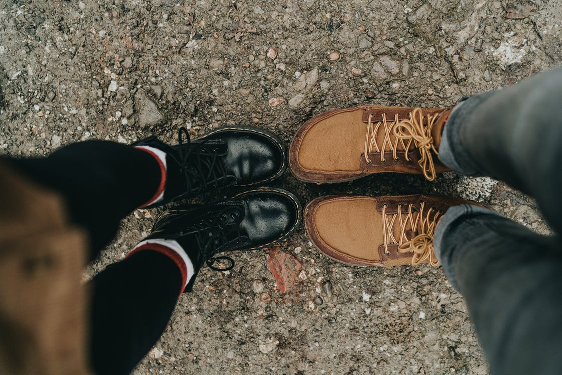 Two Pairs of Brown and Black Boots