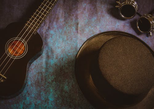Free stock photo of flat lay, glasses, goggles, guitar