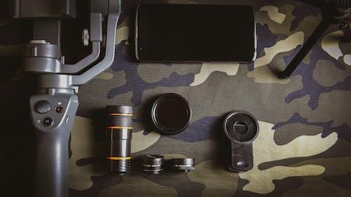 Free stock photo of camera lens, flat lay, gimbal, smartphone