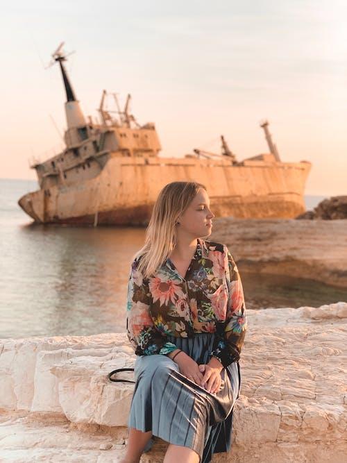 Woman Sitting on Concrete Dock