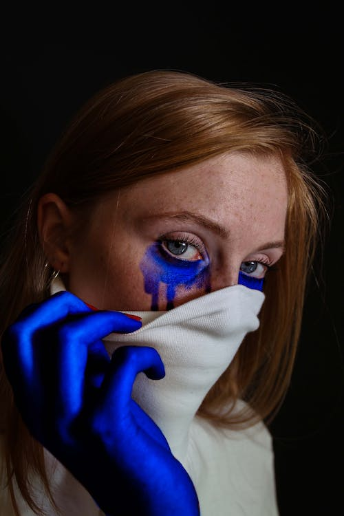Photo Of Woman With Face Paint
