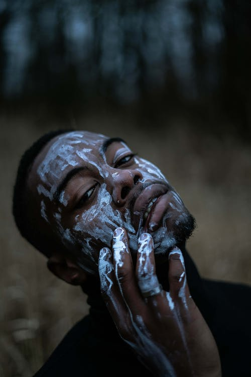 Photo Of Man Holding His Face