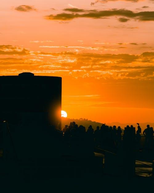 노란색, 붉은 하늘, 실루엣이 있는, 일몰의 무료 스톡 사진