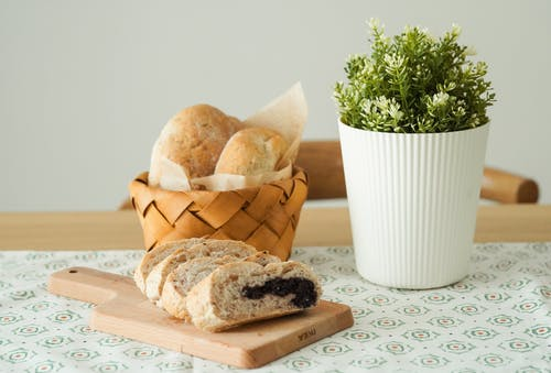 Photo Of Baked Breads Beside An Indoor Plant