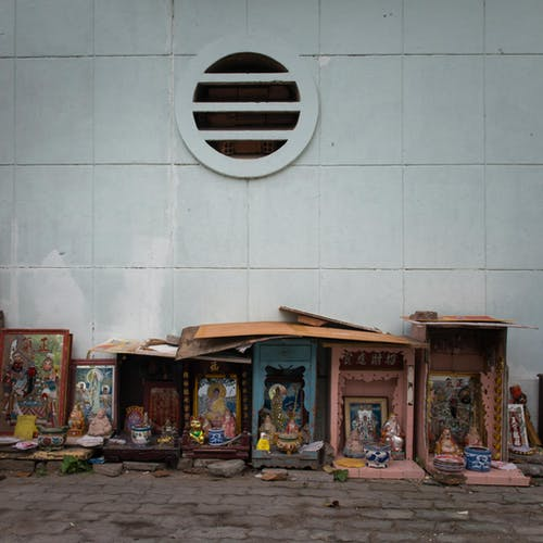 Assorted Figurines And Picture Frame On The Sidewalk