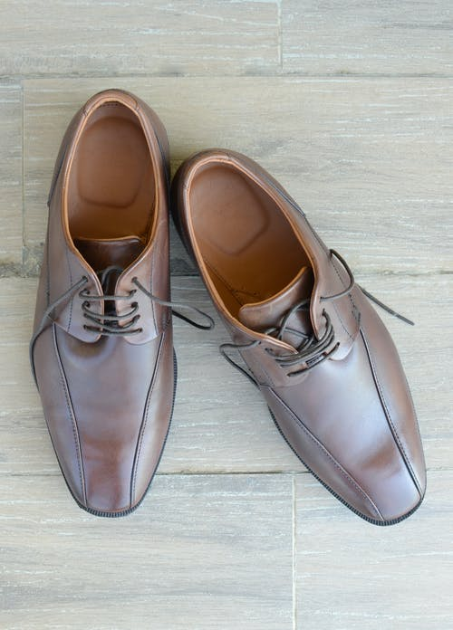 Pair of Brown Leather Dress Shoes Placed on Gray Surface