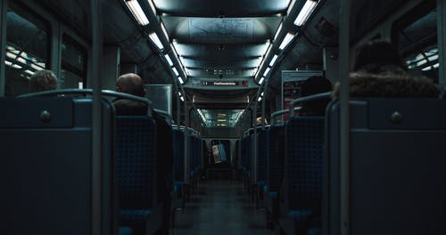 People Seated Inside a Train
