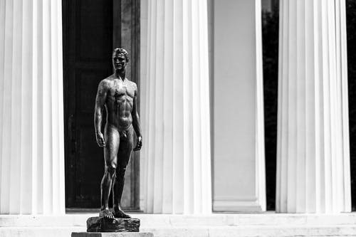 Grayscale Photography of Nude Man Standing Statue