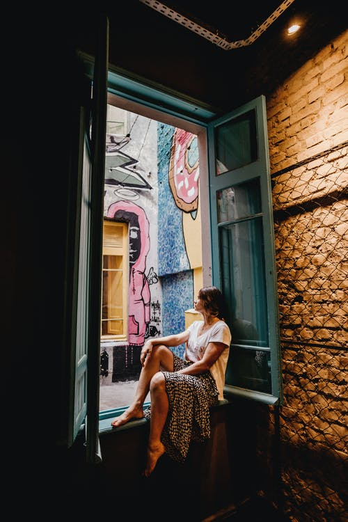 Woman Sitting by the Window