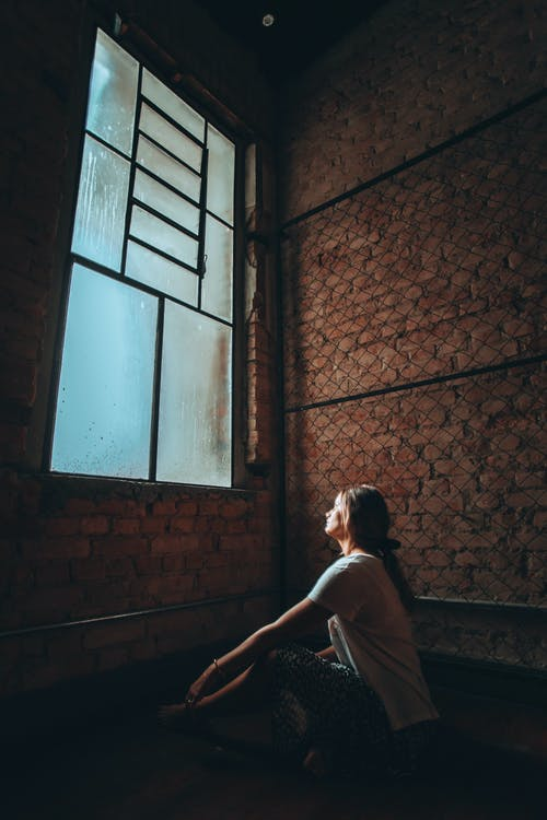 Photo Of Woman Sits Near The Window