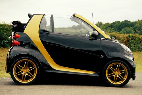 Black and Yellow Smart Car on Focus Photography