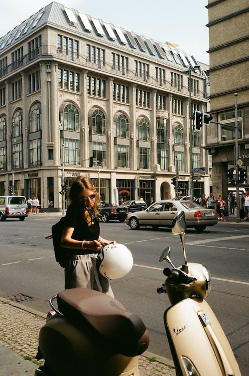 Woman Holding Helmet