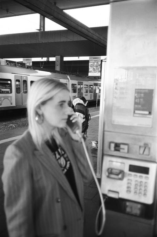 Monochrome Photo Of Woman Talking On Phone