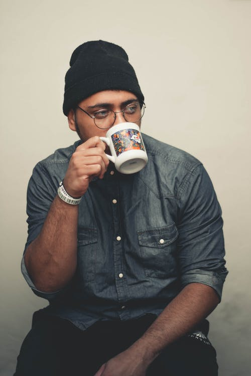 Man Drinking from Mug