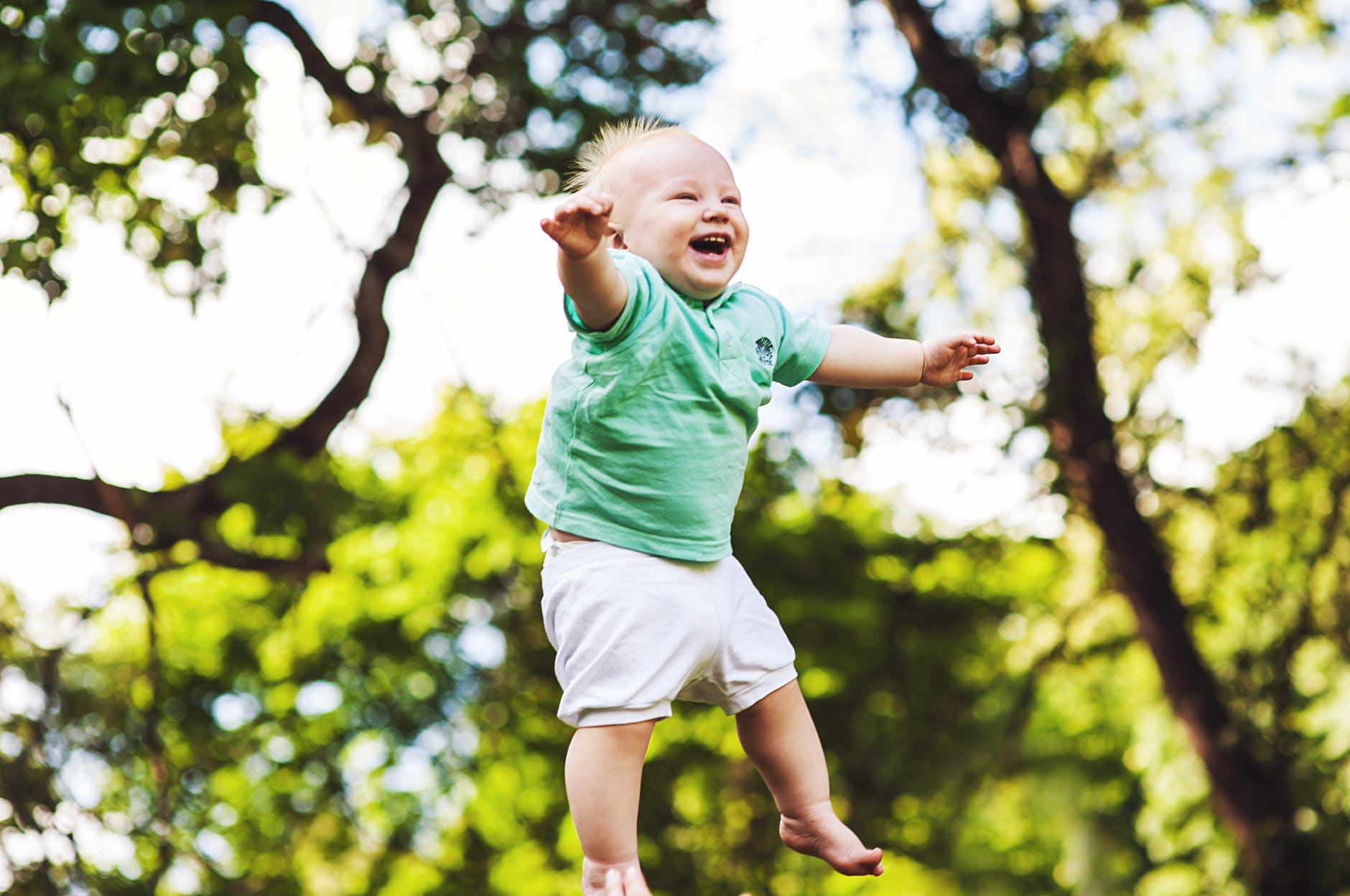 Baby tossed into air Joy on his face
