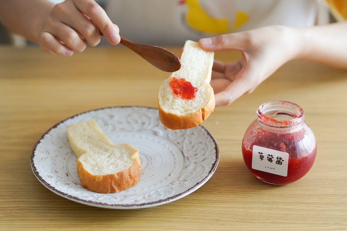 Person Holding Bread