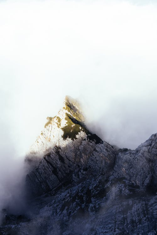Aerial Shot Of Dense Clouds  Creeping On The Mountain Peak