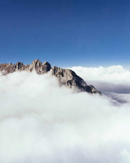 Aerial Photography of Mountain Covered With Thick Cloud Formation