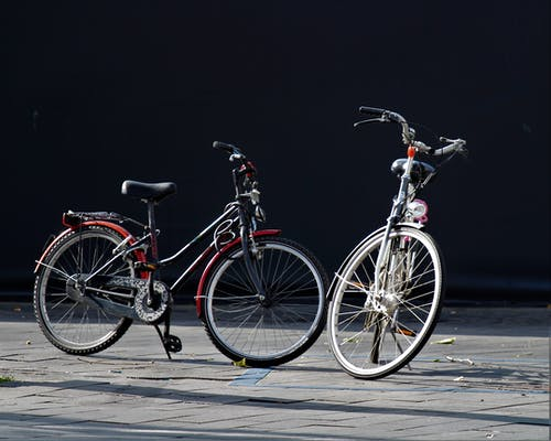 1 Gray and 1 Red Bicycles