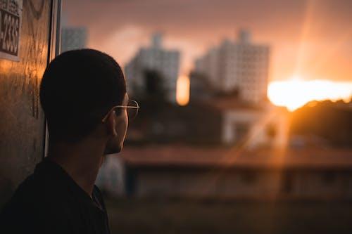 Photo Of Man Looking On Sunset