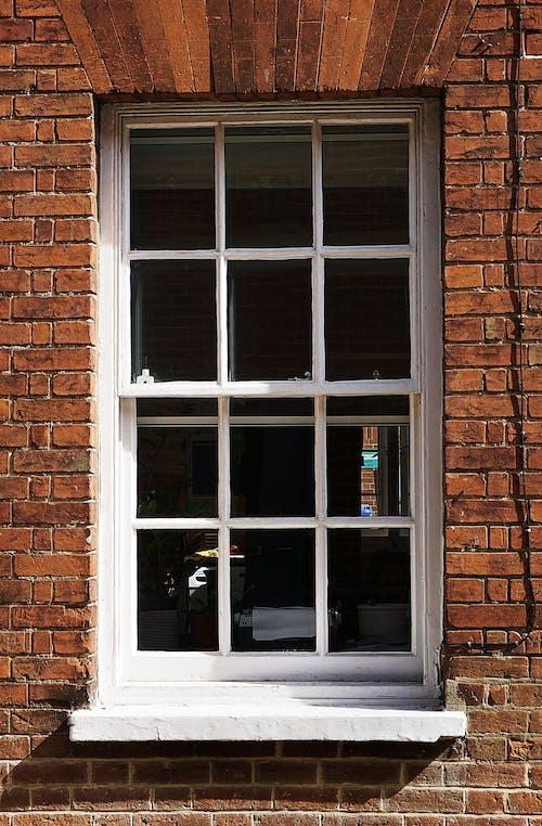 Fotos de stock gratuitas de casa antigua, edificio viejo, ladrillos rojos, muro
