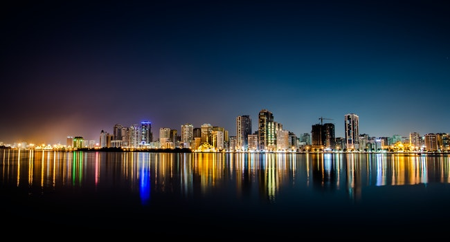 Free stock photo of city, night, water, skyline