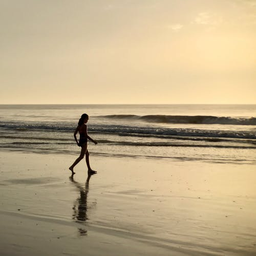 Girl Walking on Seashore