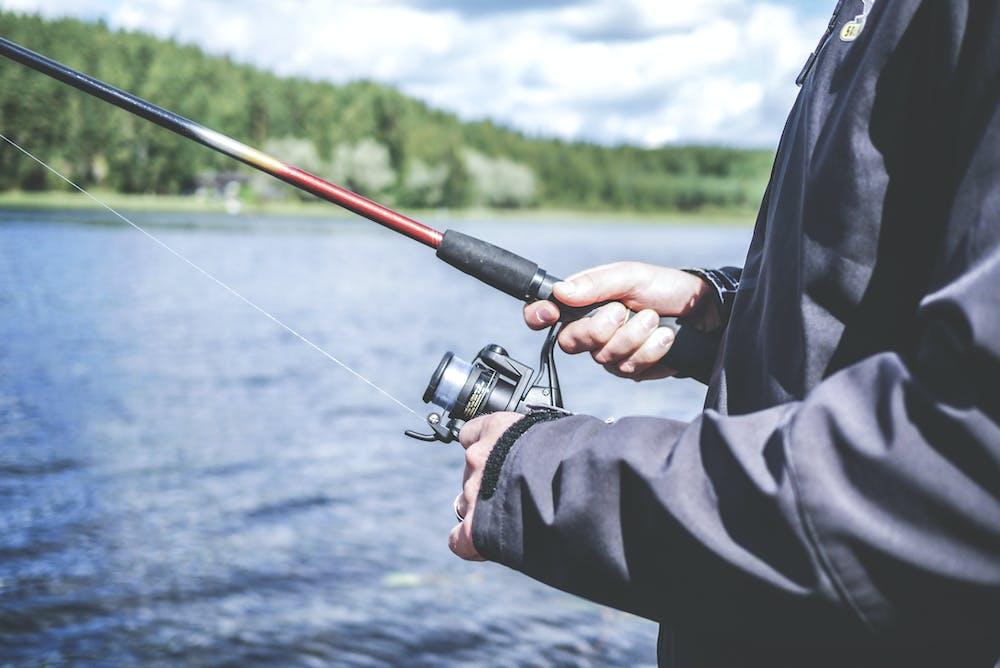 A man fishing at the lake. | Photo: Pexels