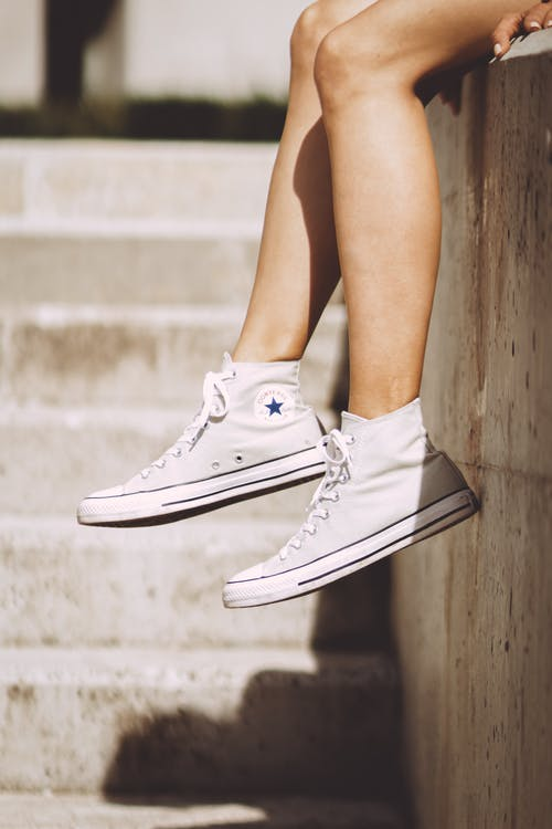 Woman Wearing White High-top Sneakers