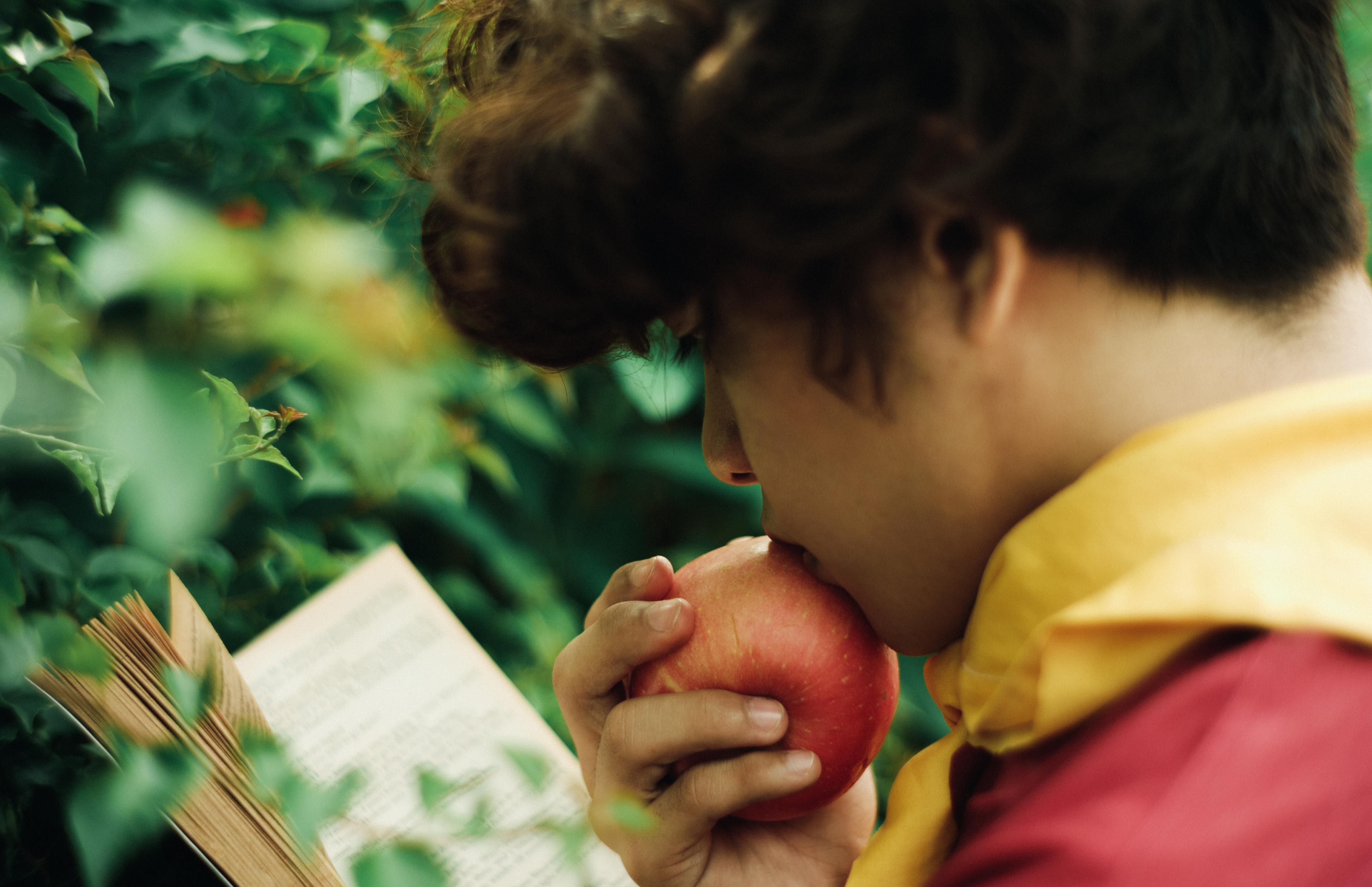 Photo Of Man Eating Apple