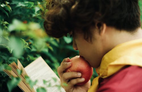Photo Of Man Eating Apple