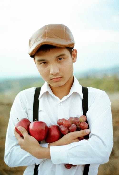 Photo Of Man Holding Fruits