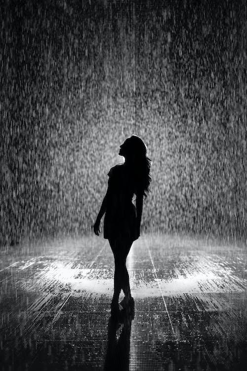 Silhouette Of Woman Under Rain