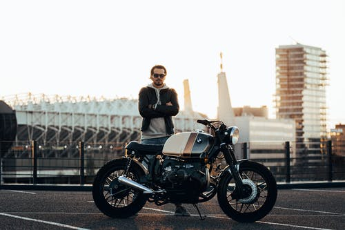 Man Standing Beside Motorcycle