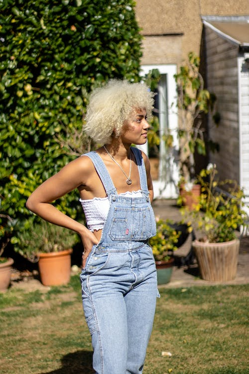 Free stock photo of 20-25 years old woman, african woman, afro hair, dungarees